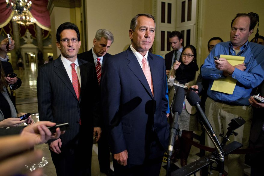 House Majority Leader Rep. Eric Cantor, R-Va., left, and House Majority Whip Rep. Kevin McCarthy, R-Calif., rear center, look on as Speaker of the House Rep. John Boehner, R-Ohio, pauses during a news conference on Capitol Hill on Tuesday, Oct. 1, 2013 in Washington. Congress was unable to reach a midnight deadline to keep the government funded, triggering the first government shutdown in more than 17 years. (AP Photo/Evan Vucci)
