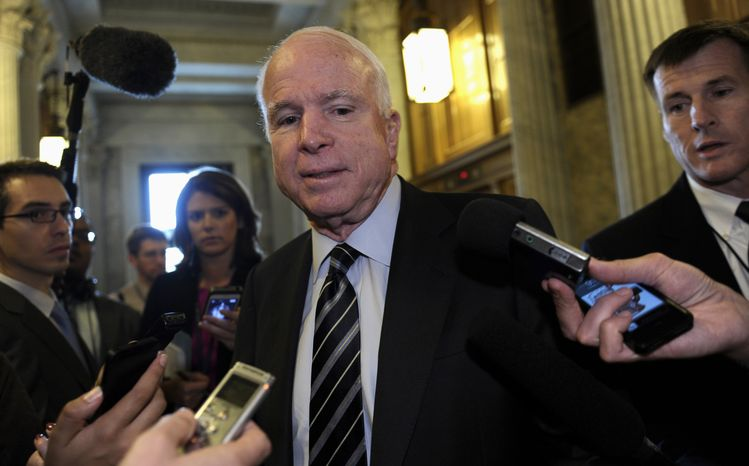 ** FILE ** Sen. John McCain, Arizona Republican, speaks with reporters on Capitol Hill in Washington on Tuesday, Oct. 1, 2013, following a vote in the Senate rejecting the latest House GOP effort to negotiate on government spending. (AP Photo/Susan Walsh)