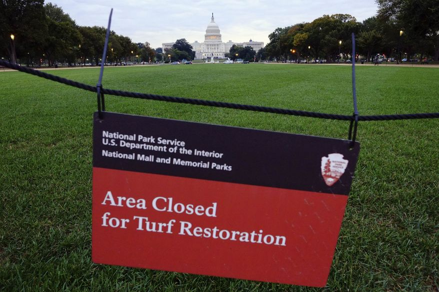 **FILE** The U.S. Capital is seen behind an area closed for restoration sign on the National Mall in Washington, Tuesday, Oct. 1, 2013. The National Parks Service will begin to close many of the nation's national parks after Congress locked in a battle over the Affordable Health Care Act failed to pass a budget resulting in the shuttering of many of the government's operations. (AP Photo/J. David Ake)