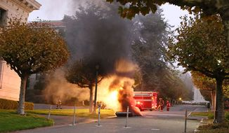This image provided by The Daily Californian shows fire and smoke from an explosion on the University of California Berkeley campus on Monday, Sept. 30, 2013, in Berkeley, Calif.  At least one person was hospitalized and a mandatory evacuation was ordered after the explosion followed a power outage across campus.  Fire crews freed about 20 people trapped in dormitory elevators across campus as a result of the outage, said U.C. Berkeley spokesman Dan Mogulof. (AP Photo/The Daily Californian, Kelly Fang)