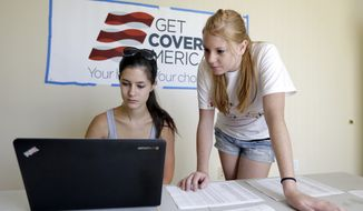 Ashley Hentze, left, of Lakeland, Fla., gets help signing up for health care from Kristen Nash, a volunteer with Enroll America, a private, nonprofit organization running a grassroots campaign to encourage people to sign up for health care, Tuesday, Oct. 1, 2013, Tampa, Fla. (AP Photo/Chris O'Meara)