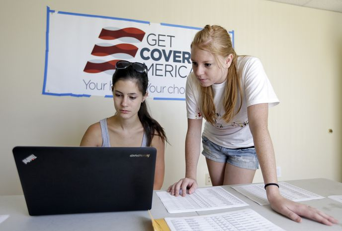 Ashley Hentze, left, of Lakeland, Fla., gets help signing up for health care from Kristen Nash, a volunteer with Enroll America, a private, nonprofit organization running a grassroots campaign to