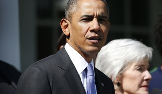 President Barack Obama speaks as he stands with Health and Human Services Secretary Kathleen Sebelius and people who support the Affordable Care Act, his signature health care law, in the Rose Garden at the White House in Washington, Tuesday, Oct. 1, 2013. Congress plunged the nation into a partial government shutdown Tuesday as a long-running dispute over President Barack Obama's health care law forced about 800,000 federal workers off the job, suspending all but essential services. (AP Photo/Charles Dharapak)