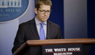 White House press secretary Jay Carney prepares to answers questions during his daily news briefing at the White House in Washington, Tuesday, Oct., 1, 2013. Congress plunged the nation into a partial government shutdown Tuesday as a protracted dispute over Obama's signature health care law reached a boiling point, forcing some 800,000 federal workers off the job. (AP Photo/Pablo Martinez Monsivais)