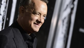 """Actor Tom Hanks arrives at the special screening of the feature film """"Captain Phillips"""" at The Academy of Motion Picture Arts and Sciences on Monday, Sept. 30, 2013 in Beverly Hills, Calif. (Photo by Dan Steinberg/Invision/AP)"""