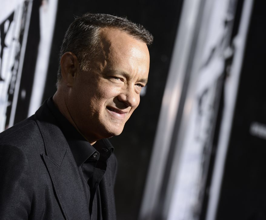 "Actor Tom Hanks arrives at the special screening of the feature film ""Captain Phillips"" at The Academy of Motion Picture Arts and Sciences on Monday, Sept. 30, 2013 in Beverly Hills, Calif. (Photo by Dan Steinberg/Invision/AP)"