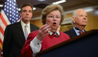 Sen. Barbara A. Mikulski of Maryland, along with Sen. Mark R. Warner of Virginia (left) and Sen. Benjamin L. Cardin of Maryland, all Democrats, urge House Republicans to pass a clean continuing resolution to end the federal government shutdown. (andrew harnik/the wasHingTON times)