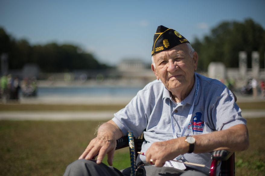 Navy veteran James Nerad Jr. visits the World War II Memorial for the first time Wednesday despite its official closure. (andrew s. geraci/the Washington Times)