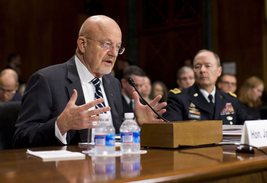Director of National Intelligence James R. Clapper (left), accompanied by Army Gen. Keith B. Alexander, National Security Agency director, testifies on Capitol Hill in Washington on Wednesday, Oct. 2, 2013, before the Senate Judiciary Committee oversight hearing on the Foreign Intelligence Surveillance Act. U.S. intelligence officials say the government shutdown is seriously damaging the intelligence community's ability to guard against threats. (AP Photo/Evan Vucci)