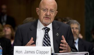 ** FILE ** National Intelligence Director James Clapper testifies on Capitol Hill in Washington, Wednesday, Oct. 2, 2013, before the Senate Judiciary Committee oversight hearing on the Foreign Intelligence Surveillance Act. U.S. intelligence officials say the government shutdown is seriously damaging the intelligence community's ability to guard against threats. (AP Photo/Evan Vucci)