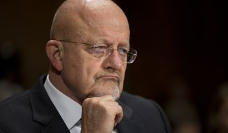 National Intelligence Director James Clapper pauses during a Senate Judiciary Committee oversight hearing on the Foreign Intelligence Surveillance Act on Capitol Hill on Wednesday, Oct. 2, 2013 in Washington. U.S. intelligence officials say the government shutdown is seriously damaging the intelligence community's ability to guard against threats. (AP Photo/ Evan Vucci)