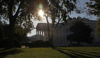 The sun rises over the White House in Washington on the second day of a federal government shutdown, Wednesday, Oct. 2, 2013. The political stare-down on Capitol Hill showed no signs of easing, leaving federal government functions in limbo from coast to coast. The White House said Wednesday that President Barack Obama would have to truncate a long-planned trip to Asia, calling off the final two stops in Malaysia and the Philippines. (AP Photo/Charles Dharapak)
