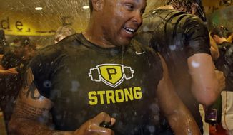 Pittsburgh Pirates' Marlon Byrd celebrates with teammates after winning the National League Wild-Card playoff baseball game 6-2 over the Cincinnati Reds in Pittsburgh Tuesday, Oct. 1, 2013. The Pirates advance to play the St. Louis Cardinals in the NLDS beginning Thursday in St. Louis. (AP Photo/Gene J. Puskar)