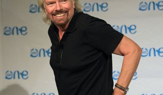 ** FILE ** British businessman Sir Richard Branson leaves after speaking to journalists at the end of the opening ceremony for the One Young World summit at Soccer City in Johannesburg, South Africa,  Wednesday, Oct. 2, 2013. (AP Photo/Themba Hadebe)