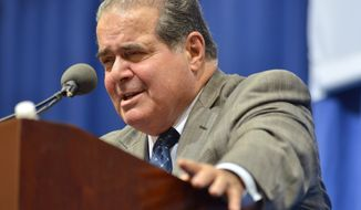 ** FILE ** Supreme Court Justice Antonin Scalia responds to a question during his appearance in part of a lecture series at Tufts University, Wednesday, Oct. 2, 2013, in Medford, Mass. (AP Photo/Josh Reynolds)