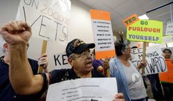 Veteran Raul Sanchez and others protests the government shutdown at the San Antonio office of  U.S. Sen. Ted Cruz. Texas is one of the richest beneficiaries of federal spending, with its military bases, Gulf Coast seaports, and nearly 2,000-mile border with Mexico. (Associated Press photographs)