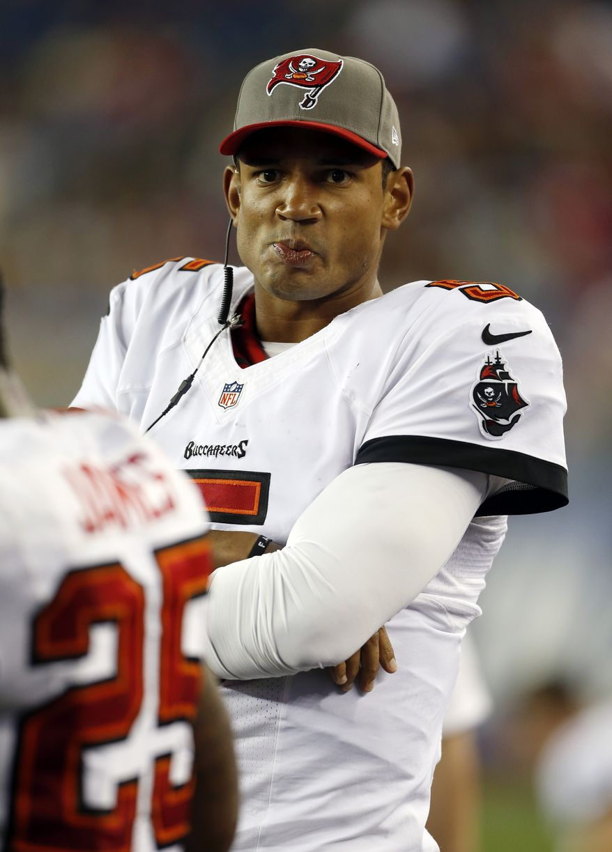 FILE - In this Aug. 16, 2013 file photo, Tampa Bay Buccaneers quarterback Josh Freeman watches from the sideline in the fourth quarter of an NFL preseason football game against the New England Patriots, in Foxborough, Mass. The Buccaneers have released Freeman, one week after benching the fifth-year pro in favor of rookie Mike Glennon. (AP Photo/Michael Dwyer, File)