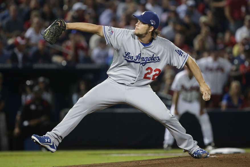 Los Angeles Dodgers starting pitcher Clayton Kershaw works in the second inning against the Atlanta Braves during Game 1 of the National League Division Series, Thursday, Oct. 3, 2013, in Atlanta. (AP Photo/John Bazemore)
