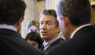 Sen. Rand Paul, Kentucky Republican, leaves the Senate chamber on Capitol Hill in Washington on Wednesday, Sept. 25, 2013, after a procedural vote on a bill to fund the government. Potential 2016 presidential candidates now in Congress, including Mr. Paul, have been relatively silent about a partial government shutdown. (AP Photo/J. Scott Applewhite)