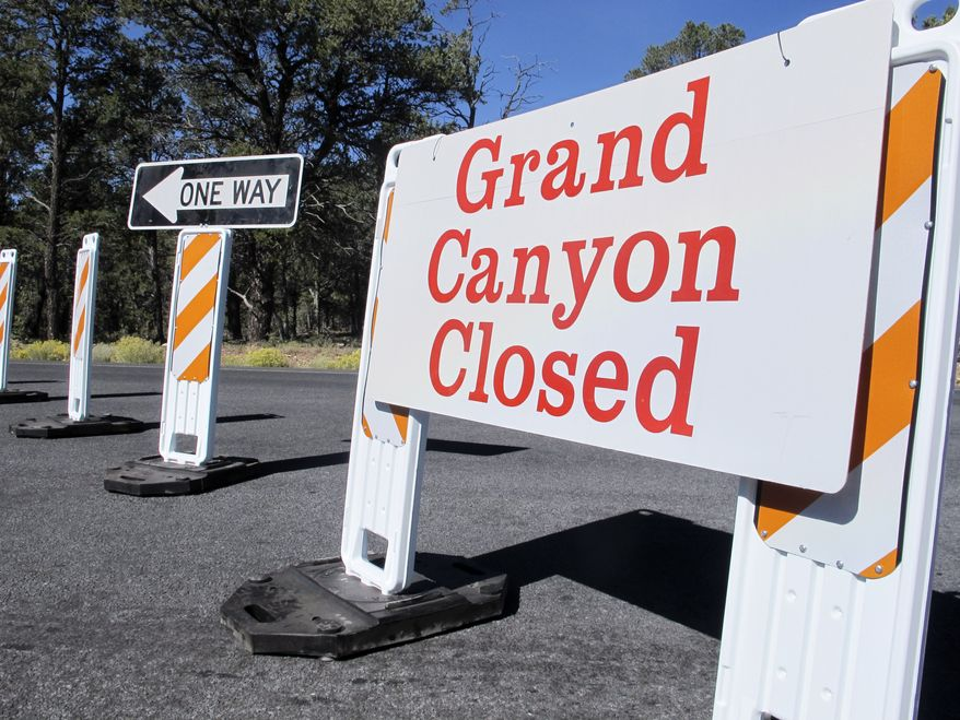 A sign at the south entrance to Grand Canyon National Park, Ariz., indicates the park is closed on Thursday, Oct. 3, 2013.  More than 400 national parks are closed as Congress remains deadlocked over federal government funding.  (AP Photo/Brian Skoloff)