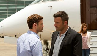 "Richie (Justin Timberlake, left) is broke and looking for a satanic master to buy his soul when he chases down Ivan (Ben Affleck), owner of a gambling operation, in ""Runner Runner."" (20th Century Fox credit via associated press)"