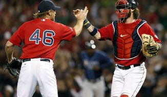 Boston Red Sox closing pitcher Ryan Dempster (46) and catcher Jarrod Saltalamacchia, right, celebrate their 12-2 win over the Tampa Bay Rays in Game 1 of baseball's American League division series, Friday, Oct. 4, 2013, in Boston.  (AP Photo/Michael Dwyer)