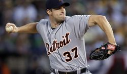 Detroit Tigers pitcher Max Scherzer winds up during the second inning of Game 1 of the American League baseball division series against the Oakland Athletics in Oakland, Calif., Friday, Oct. 4, 2013. (AP Photo/Marcio Jose Sanchez)