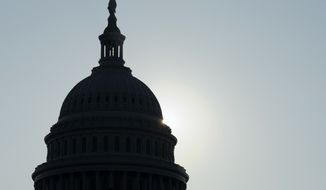 The sun peeks from behind the Capitol dome on Capitol Hill in Washington on Friday, Oct. 4, 2013, as the budget battle continues. (AP Photo/Susan Walsh)