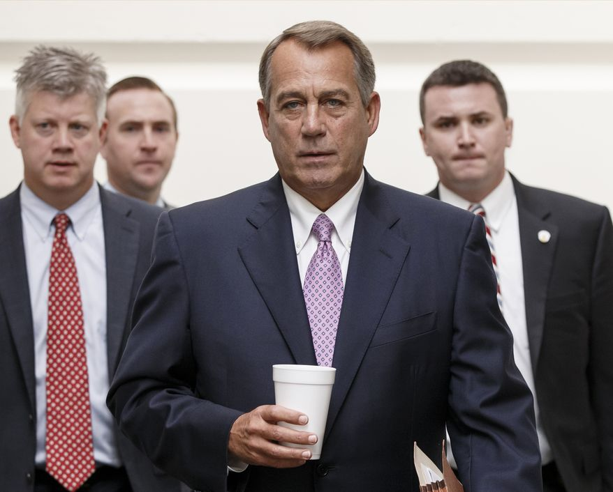 House Speaker John Boehner of Ohio walks to a Republican strategy session on Capitol Hill in Washington, Friday, Oct. 4, 2013. Boehner is struggling between Democrats that control the Senate and GOP conservatives in his caucus who insist any funding legislation must also kill or delay the nation's new health care law. Added pressure came from President Barack Obama who pointedly blamed Boehner on Thursday for keeping federal agencies closed. (AP Photo/J. Scott Applewhite)