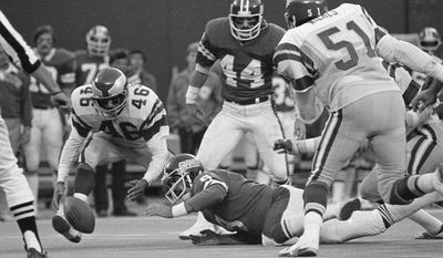 FILE - In this Nov. 19, 1978, file photo, Philadelphia Eagles' Herman Edwards pounces on the ball just fumbled by New York Giants quarterback Joe Pisarcik late in an NFL football game in East Rutherford. Edwards went in for the score and the Eagles won 19-17. The Eagles have enjoyed some of their greatest moments on the road against the Giants. Chip Kelly, the Eagles' coach, certainly doesn't need a refresher course before Sunday's game between the two struggling teams. He knows Philadelphia (1-3) and New York (0-4) go back a long way. (AP Photo/G. Paul Burnett, File)