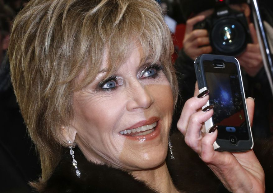 FILE - Actress Jane Fonda arrives for the screening of the film Promised Land at the 63rd edition of the Berlinale, International Film Festival in Berlin, Germany, in this Feb. 8, 2013 file photo. Fonda will receive the American Film Institute's 42nd Life Achievement Award, one of Hollywood's most prestigious career honors. The AFI award will be presented at a star-studded gala on June 5, 2014. (AP Photo/Gero Breloer, File)