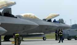 ** FILE ** Air Force F-22 Raptors, made by Lockheed Martin. (Associated Press)