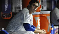 FILE - In this April 19, 2013, file photo, New York Mets starting pitcher Matt Harvey sits the dugout during a baseball game against the Washington Nationals in New York. The Mets said Friday, Oct. 4, 2013, that Dr. James Andrews will operate on Harvey's partially torn ligament in his right elbow in October. (AP Photo/Kathy Kmonicek, File)