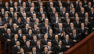 ** FILE ** Members of the Mormon Tabernacle Choir look on during the 183rd Annual General Conference of The Church of Jesus Christ of Latter-day Saints, in Salt Lake City, April 6, 2013, (AP Photo/Rick Bowmer, File)