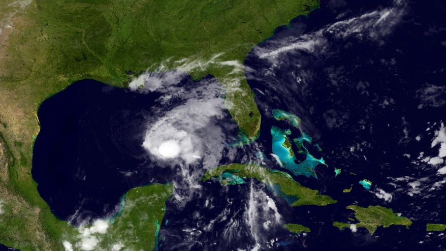 This image provided by NOAA shows Tropical Storm Karen taken late Thursday night Oct. 3, 2013. The National Hurricane Center in Miami said late Thursday that Karen was about 340 miles (547 kilometers) south of the mouth of the Mississippi River and had maximum sustained winds of 65 mph (100 kph) with higher gusts. The storm was moving north-northwest at 10 mph (16 kph). It could be at or near hurricane strength late Friday and early Saturday, forecasters said, with the center near the coast on Saturday. (AP Photo/NOAA)