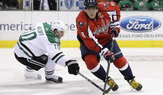 Washington Capitals' Alex Ovechkin (8), of Russia, controls the puck as he gets by Dallas Stars' Shawn Horcoff (10) in the first period of an NHL hockey game on Saturday, Oct. 5, 2013, in Dallas. (AP Photo/Tony Gutierrez)