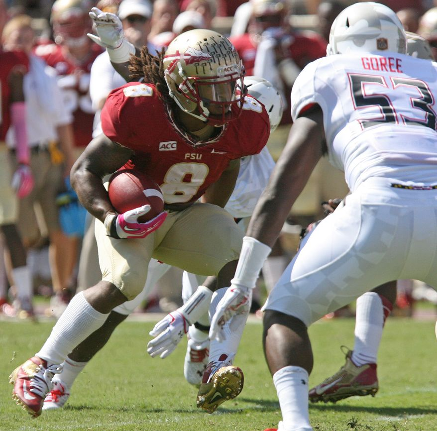 Florida State's Devonta Freeman looks for an opening against Maryland in the first quarter of an NCAA college football game on Saturday, Oct. 5, 2013, in Tallahassee, Fla. Florida State qon 63-0. (AP Photo/Steve Cannon)
