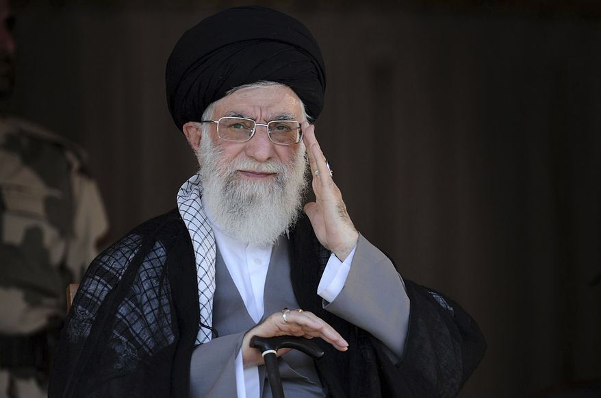 In this picture released by an official website of the office of the Iranian supreme leader, Supreme Leader Ayatollah Ali Khamenei, center, attends a graduation ceremony of army cadets, in Tehran, Iran, Saturday, Oct. 5 2013. Iran's top leader hinted Saturday that he disapproved of the phone call between Presidents Hassan Rouhani and Barack Obama during the Iranian leader's trip to New York last month, but he reiterated his crucial support for the president's policy of outreach to the West. (AP Photo/Office of the Iranian Supreme Leader)