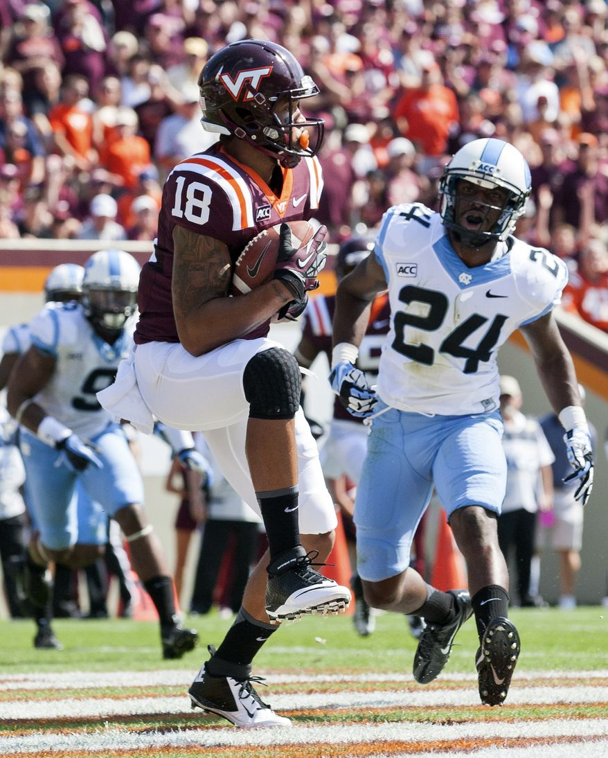 Virginia Tech's D.J. Coles (18) pulls in a touchdown pass against North Carolina's Jordan Darty (24) during an NCAA college football game Saturday, Oct. 5, 2013 in Blacksburg, Va. Virginia Tech won 27-17. (AP Photo/The Roanoke Times, Joel Hawksley) LOCAL TV OUT; SALEM TIMES REGISTER OUT; FINCASTLE HERALD OUT;  CHRISTIANBURG NEWS MESSENGER OUT; RADFORD NEWS JOURNAL OUT; ROANOKE STAR SENTINEL OUT
