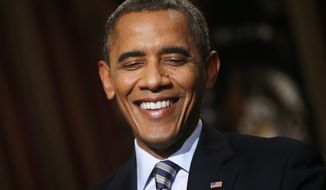 ** FILE ** President Obama smiles during an exclusive interview with The Associated Press in the White House library in Washington, Oct. 4. 2013. (AP Photo/Charles Dharapak)