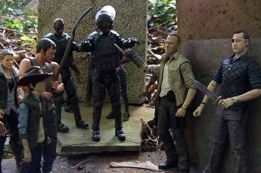 The Governor and Merle are threatened by Andrea, Carl and Daryl as Riot Gear Zombie and Riot Gear Gas Mask Zombie attack in McFarlane Toys' The Walking Dead TV Series action figure collection. (Photo by Joseph Szadkowski/The Washington Times)