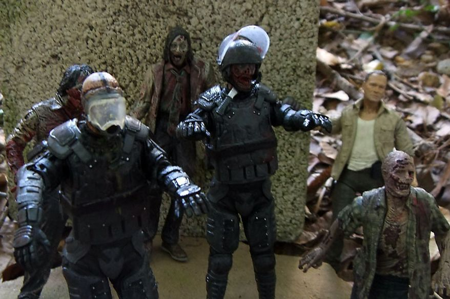 Riot Gear Zombie and Riot Gear Gas Mask Zombie look for easy prey as Merle Dixon looks for help in McFarlane Toys' The Walking Dead TV Series action figure collection. (Photo by Joseph Szadkowski/The Washington Times)