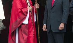 Cardinal Donald Wuerl speaks with Supreme Court Chief Justice John G. Roberts Jr. after the Mass, during which Dallas Bishop Kevin J. Farrell issued a plea for unity as a government shutdown moves into week two.