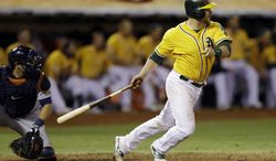Oakland Athletics Stephen Vogt makes a game winning hit in the bottom of the ninth inning to beat the Detroit Tigers 1-0 in Game 2 of an American League baseball Division Series in Oakland, Calif., Saturday, Oct. 5, 2013. (AP Photo/Ben Margot)