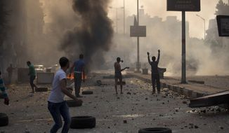 Supporters and opponents of ousted Egyptian President Mohammed Morsi clash in Cairo on Sunday, Oct. 6, 2013, as the nation marked the anniversary of the last war with Israel. (AP Photo/Hassan Ammar)