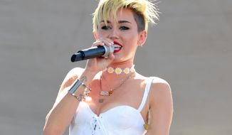 Miley Cyrus performs at IHeartRadio Music Village in Las Vegas on Saturday, Sept. 21, 2013. (Al Powers/Powers Imagery/Invision/AP)