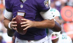Baltimore Ravens quarterback Joe Flacco (5) looks to pass during the second half of an NFL football game against the Miami Dolphins, Sunday, Oct. 6, 2013, in Miami Gardens, Fla. (AP Photo/J Pat Carter)
