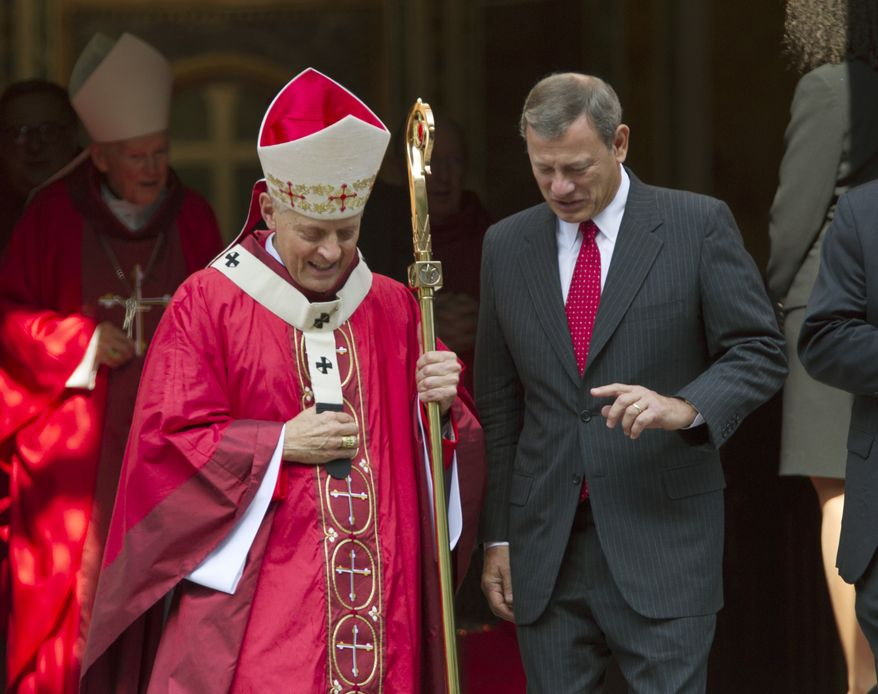 Cardinal Donald Wuerl (left), archbishop of Washington, walks with Chief Justice John G. Roberts Jr. as they leave the Cathedral of St. Matthew the Apostle in Washington after the annual Red Mass on Sunday, Oct. 6, 2013. The Supreme Court's new term starts Monday. (AP Photo/Jose Luis Magana)