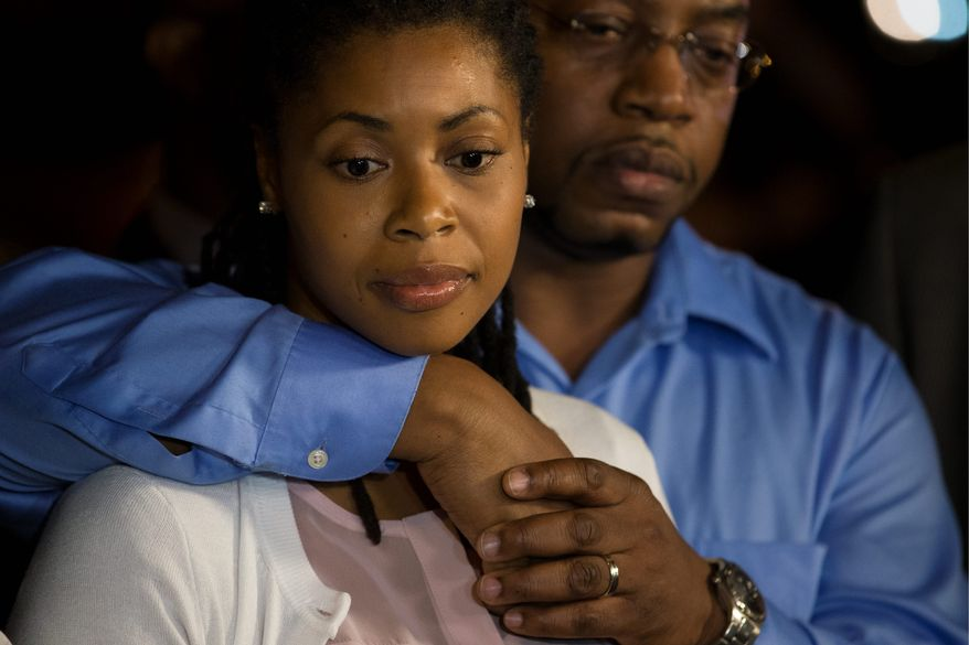 Amy Carey-Jones, sister of Miriam Carey, speaks to the media outside the home of her sister Valarie in Brooklyn, N.Y. Ms. Carey's family said Monday they don't believe her shooting after the pursuit that led to the U.S. Capitol was warranted. (Associated Press)