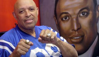 FILE - In this March 22, 2007 file photo, Hall of Fame tight end John Mackey shows off his Super Bowl V rings  at his Baltimore home. Mackey died in 2011 after a 10-year battle with dementia. His wife, Syvia, remained by his side throughout, and she continues to show her support by educating parents, mental health providers and athletes about sports-related head injuries.  (AP Photo/Steve Ruark, File)
